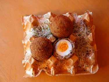 Six Geese-a-Laying- Scotch eggs served with a lemon gribiche in a golden egg tray.